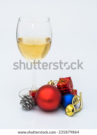 glass of wine with Christmas ornaments
