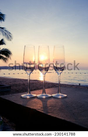 Glass of wine with evening light sea.