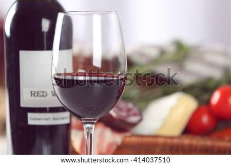 Glass of wine with food closeup - stock photo