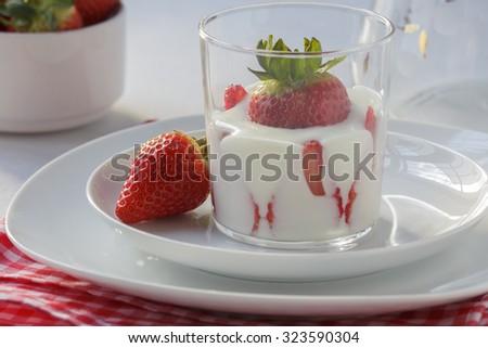 glass of yogurt with strawberries - stock photo