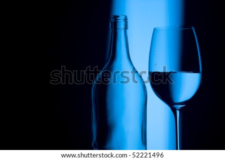 Glass on creative blue background