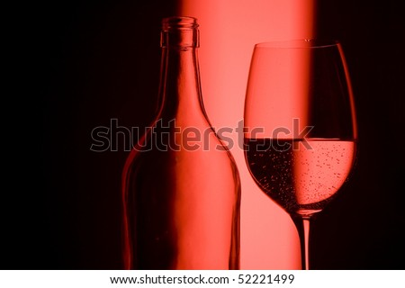Glass on creative red background