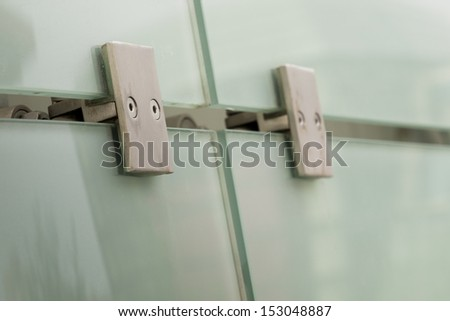 Glass panels with metal connectors