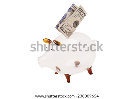 Glass piggy bank, with US $100 bill  - stock photo