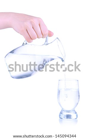 Glass pitcher of water and glass isolated on white