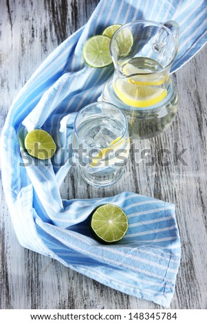Glass pitcher of water and glass on wooden table close-up - stock photo