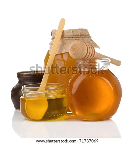 glass pot full of honey isolated on white background - stock photo
