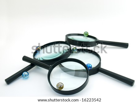 Glass products like marbles, magnifiers or lenses. - stock photo