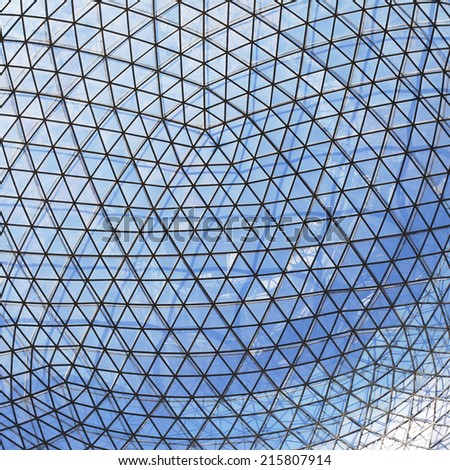 Glass roof with blue sky - stock photo