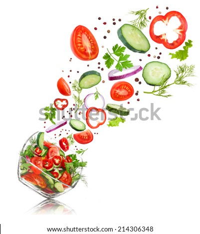 glass salad bowl in flight with vegetables: tomato, pepper, cucumber, onion, dill and parsley. Isolated on white background - stock photo
