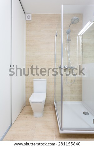 Glass shower inside contemporary bathroom