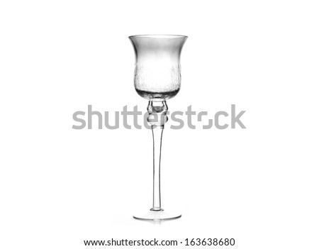 Glass single candlestick isolated on white background.
