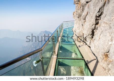 Glass sky walk at Tianmenshan Tianmen Mountain China - stock photo