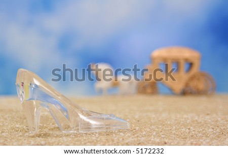 Glass Slipper on Beach With Carriage in Background, Shallow DOF - stock photo