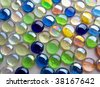 Glass spheres on a light, structural paper - stock photo
