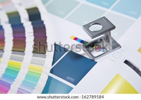 Glass standing on a leaf of the test print - stock photo