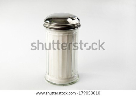 Glass Sugar Container Filled With Sugar - stock photo