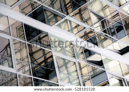 Glass surface of skyscrapers. Architecture and building pattern in warm colors. Abstract background, architectural detail.