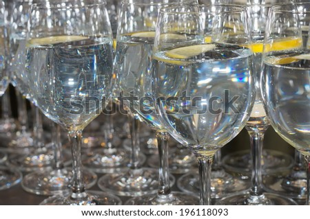 glass table restaurant water drink lemon abstract background