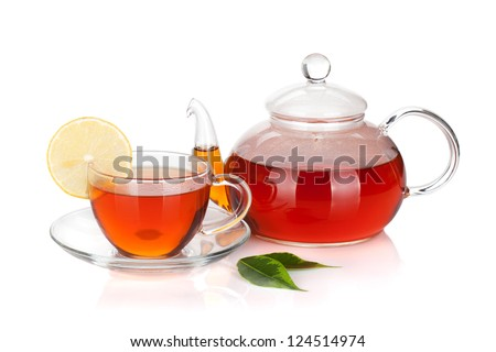 Glass teapot and cup of black tea with lemon slice. Isolated on white background - stock photo