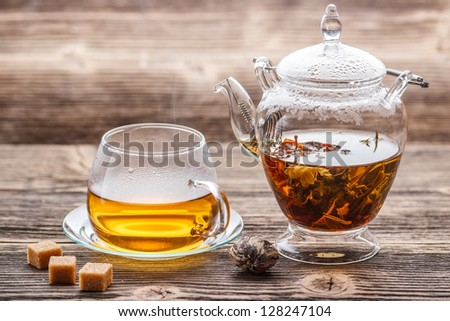 Glass teapot and cup with exotic green tea