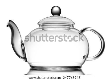 Glass teapot isolated on white - stock photo