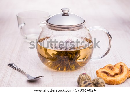 Glass teapot with Flower Chinese tea - stock photo