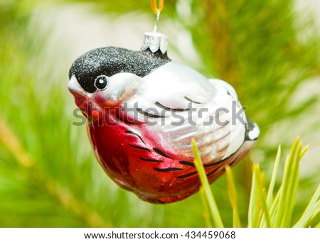 Glass toy bullfinch decorate the Christmas tree - stock photo