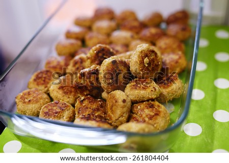 Glass tray full with delicious meatballs on table, closeup image with selective focus - stock photo