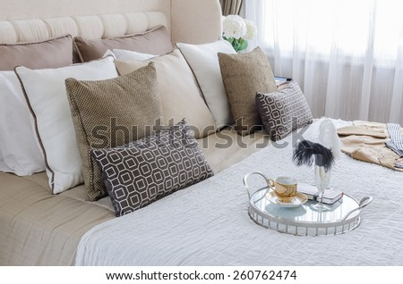 glass tray of tea cup on bed in bedroom at home - stock photo