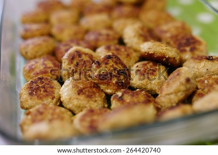 Glass tray with delicious fried meatballs - stock photo