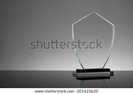 glass trophy in gray background - stock photo