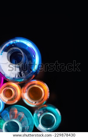 Glass tubes with multi-color liquids in isolation - stock photo