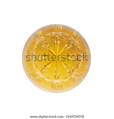 Glass tumbler filled with whiskey bourbon isolated over the white background, top view above foreshortening composition - stock photo