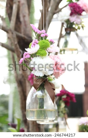 Glass vase with flowers, a beautiful ornament in a wedding