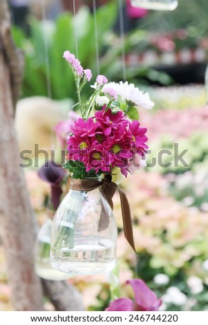 Glass vase with flowers, a beautiful ornament in a wedding - stock photo