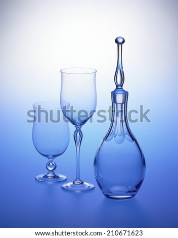 Glass Vessels Placed In A Blue Gradient Background