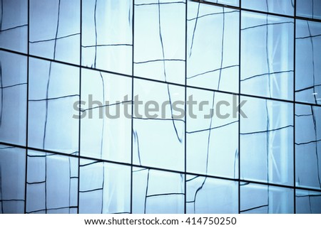 Glass wall in modern office building - stock photo