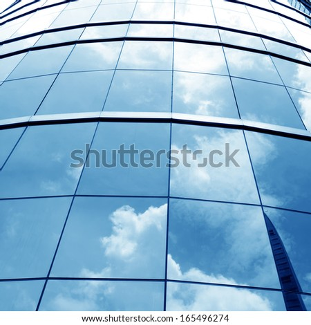 Glass wall of modern high-rise building - stock photo