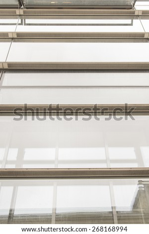 glass wall of office building with reflect