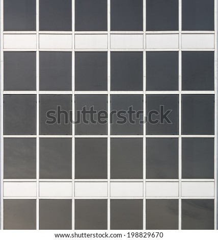 Glass walls and windows of a modern office building - stock photo