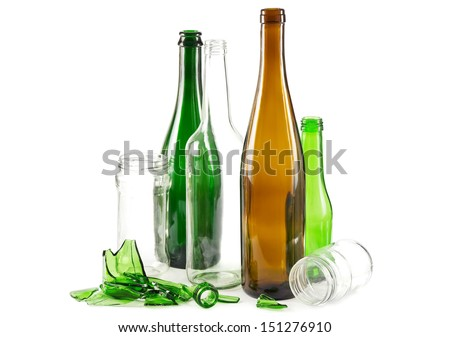 Glass waste with mixed bottles in green white and brown and empty glass jars - stock photo