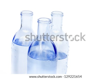 Glass water bottles isolated.