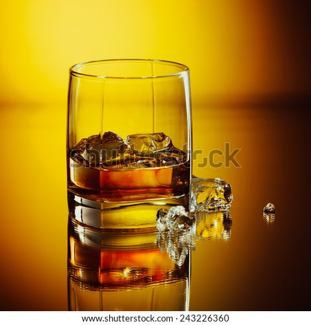 Glass whiskey and ice. Alcoholic cocktails  - stock photo