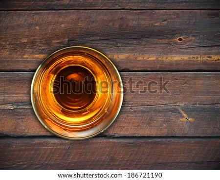 glass whiskey vintage wooden background. - stock photo