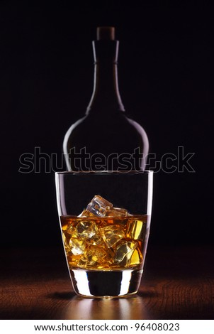 glass whiskey with bottle - stock photo