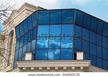 Glass window reflect cloud sky - stock photo