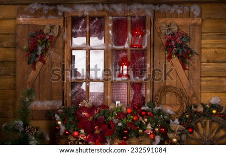 Glass Window with Wooden Frames Decorated with Beautiful Assorted Christmas Ornaments - stock photo