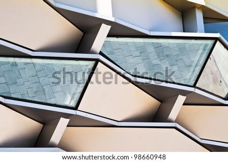 glass windows in front of modern building, located in Zaragoza, Spain. - stock photo
