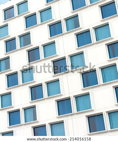 Glass windows of building close up - stock photo